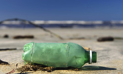 Browse partner plastic bottle wsahed up beach
