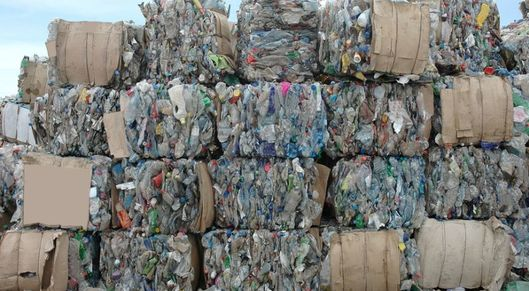Partner show plastic waste for recycling piled up